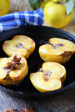 Baked quince with honey in a pan Royalty Free Stock Photography