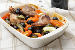 Baked rabbit with vegetables. In rectangular ceramic bowl Royalty Free Stock Image