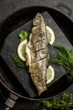 Baked rainbow trout fish with dill and lemon. Restaurant. Seafood stock photo