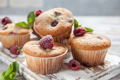 Baked Raspberry Muffins. On a old white wooden table Royalty Free Stock Photos