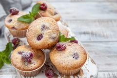 Baked Raspberry Muffins. On a old white wooden table Stock Photo