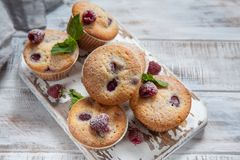 Baked Raspberry Muffins. On a old white wooden table Stock Images