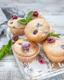 Baked Raspberry Muffins. On a old white wooden table Stock Photos