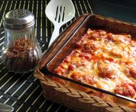 Baked Ravioli. Ravioli, baked with sauce and cheese, hot from the oven royalty free stock image