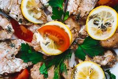 Baked red fish with vegetables, close-up royalty free stock images