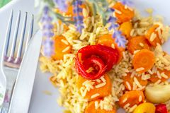 Baked red pepper and cooked white rice with delicious carrots. Lavender royalty free stock photos