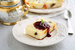 Baked rice pudding with cranberry jam, dried fruits and raisins Stock Photography