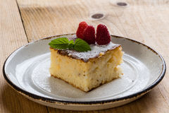 Baked rice pudding with raspberry Stock Image