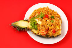 Baked rice and seafood in pineapple Stock Image