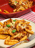 Baked Rigatoni Pasta Meal. Baked rigatoni pasta with bolognese sauce and cheese Stock Photos