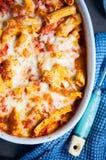Baked rigatoni pasta. Oven baked rigatoni pasta in tomato sauce Royalty Free Stock Photos