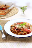 Baked Rigatoni with salami in tomato cream sauce Stock Photos