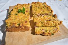 Baked or roasted egg pie or kind of quiche, french style snack served on the chopping board. Stock Photo