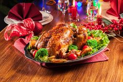 Baked or roasted whole chicken on Christmas table stock photo