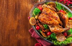 Baked or roasted whole chicken on Christmas table royalty free stock photo