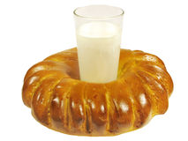 Baked roll with a glass of milk Stock Image