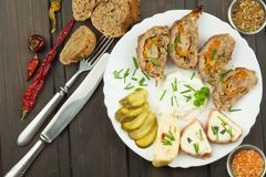 Baked roll with minced meat, cheese rolls and mayonnaise. Homework refreshments at the party. Stock Photo