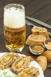 Baked roll with minced meat, cheese rolls and mayonnaise. Homework refreshments at the party. Stock Photography