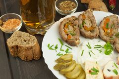 Baked roll with minced meat, cheese rolls and mayonnaise. Homework refreshments at the party. Royalty Free Stock Photo
