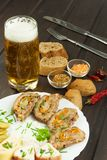 Baked roll with minced meat, cheese rolls and mayonnaise. Homework refreshments at the party. Royalty Free Stock Photos