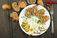 Baked roll with minced meat, cheese rolls and mayonnaise. Homework refreshments at the party. Royalty Free Stock Image
