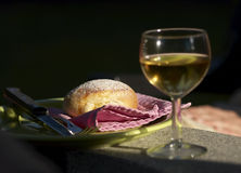 Baked roll and white wine Stock Image