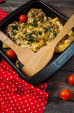 Baked rolled pasta with forcemeat and cheesy tomato sauce Stock Images