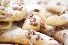 Baked Rolls. A detail of a pile of baked rolls with wallnuts and powdered sugar Stock Image