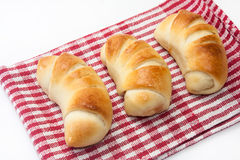 Baked rolls on the kitchen tablecloth Royalty Free Stock Photography