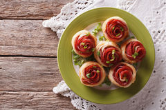 Baked rolls with salami in the form of roses. horizontal top vie stock image