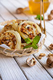 Baked rolls stuffed with walnuts, raisins and honey Stock Image