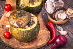 Baked round squash stuffed with mushrooms Royalty Free Stock Image