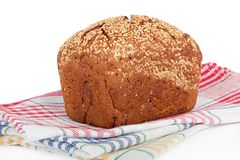Baked rye bread with linseeds. On the white  background Royalty Free Stock Photos