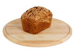 Baked rye bread with linseeds. On the white isolated background Royalty Free Stock Photography