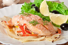 Baked salmon. With vegetables in an envelope Stock Photos