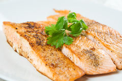 Baked salmon. A shot of baked salmon on a white plate Stock Photos