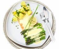 Baked salmon with asparagus Stock Photos