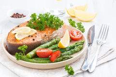 Baked salmon with asparagus, parsley and lemon Stock Images