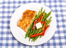 Baked Salmon with Asparagus and Red Peppers with Butter royalty free stock photo
