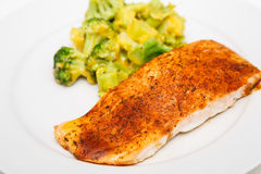 Baked Salmon and Broccoli with Cheese Sauce Stock Photo