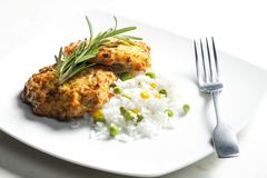 Baked salmon burgers with vegetables rice. Inside, indoor, indoors, interior, interiors, gastronomy, cuisine, foodstuff, aliment, aliments, meal, meals royalty free stock photo