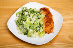 Baked Salmon with Ceasar Salad on Square Plate Royalty Free Stock Photos