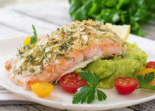 Baked salmon with cheese and almond, with mashed potatoes and green peas Royalty Free Stock Photos