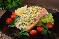 Baked salmon with cheese and almond, with mashed potatoes and green peas Stock Image