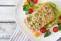 Baked salmon with cheese and almond, with mashed potatoes and green peas Stock Photos