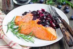 Baked salmon fillet with blueberry and rosmarin sauce, horizontal Stock Photography