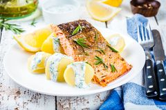 Baked salmon fillet and boiled potatoes Stock Photo