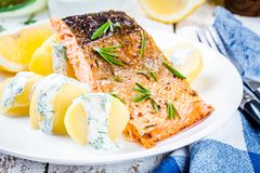 Baked salmon fillet and boiled potatoes Stock Images