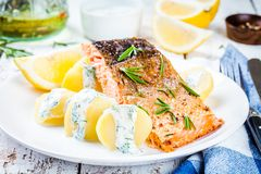 Baked salmon fillet and boiled potatoes Stock Photos