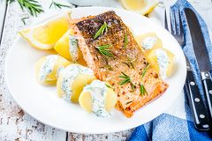 Baked salmon fillet and boiled potatoes Stock Image